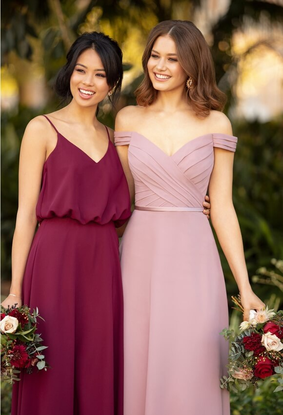 Bridesmaids wearing long evening dresses
