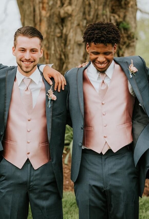 Groomsmen wearing gray tuxedos